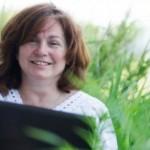 Janna Rasmussen working outside on her laptop