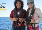 professor and student wear wet suits on a boat