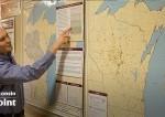 professors analyzing a map