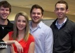 Skyward Grads are seen smiling in their office