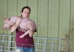 UW-River Falls girl holds pig