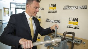 Andy Lobo, director of product management and development at Snap-on Inc., demonstrates an ergonomic wrench designed at UWM. The wrench sold by Snap-on will reduce injuries among workers in the gas utility industry.