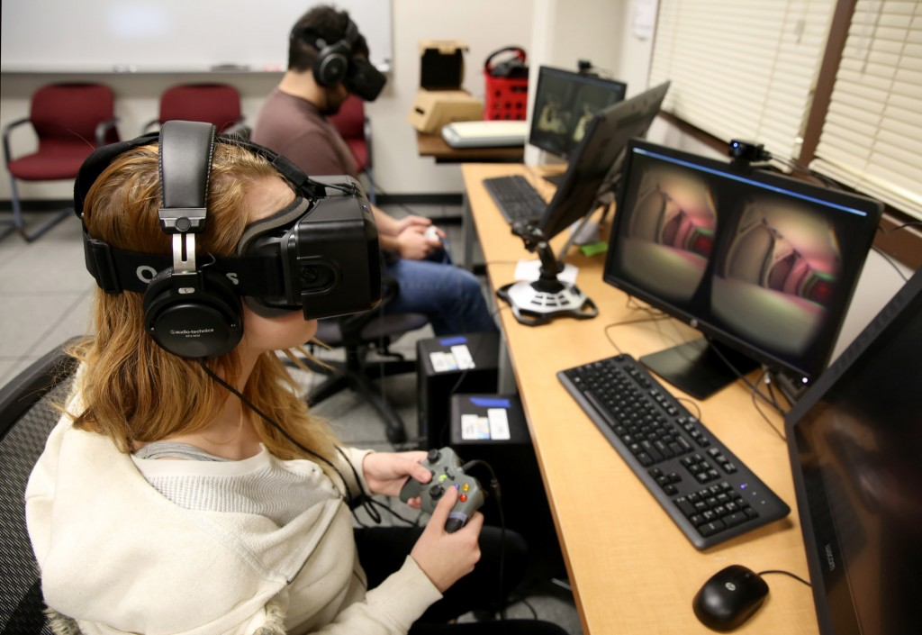 Students use the Oculus Rift in the Game Design and Development computer lab during winter term classes Wednesday, January 14, 2015. Students in the game design and development program will once again travel to L.A. to present their projects to the Jim Henson Company. This time, they are working with the Oculus Rift, a head-mounted virtual reality display.(UW-Stout photo by Brett T. Roseman)