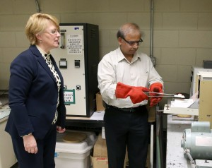Natalia Sobczak, of Poland, and UW-Stout's Rajiv Asthana conduct a test on wetting of an oxide ceramic by molten copper in the Ceramic and Powder Metallurgy Lab in Fryklund Hall.