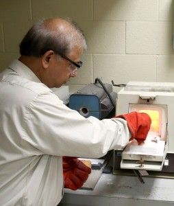 UW-Stout's Rajiv Asthana, who does research for NASA, conducts a test in the Ceramic and Powder Metallurgy Lab at UW-Stout.