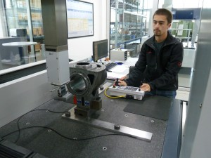 UW-Stout manufacturing engineering student Michael Guzman works with the Coordinate Measuring Machine at Fischer AG in Switzerland.