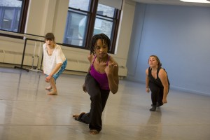 Davalois Fearon (center) rehearses with dancers Chloë Nagle, a recent BFA dance graduate, and Chelsey Becher, a sophomore in dance who spent a semester abroad in Paris. (UWM Photo/Derek Rickert)