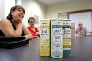 From left, Aunt K's All Natural Remedies owners Kay Widule and Sharon Horstman discuss their product with Roger Gehring of UW-Stout's Discovery Center.