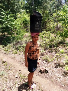 Desys Jarquin of Las Macias, Nicaragua, carries water from the village well back to the village.