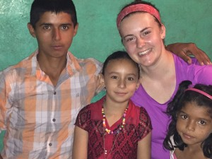 UW-Stout student Allison Roush, second from right, takes a selfie with Las Macias residents, from left, Julio Garcia, Neybeli Jarquin and Anyeli Nathalia.
