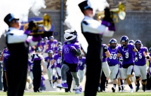 Willie Warhawk leads the team onto the field for the home opener. The University of Wisconsin-Whitewater football team defeated Finlandia University 66-3 at Perkins Stadium in Whitewater, Wis. on Saturday, September 19, 2015. (UW-Whitewater Photo/Craig Schreiner)