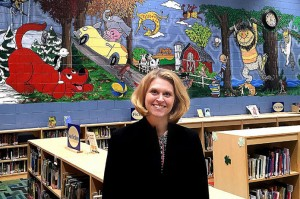 Tami Weiss painted a large mural at River Heights Elementary School to recognize the work of illustrators, the artists of children's books. The mural has also inspired children to read. See video at www.leadertelegram.com