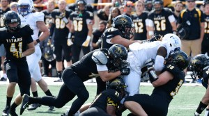 Members of the UW-Oshkosh Titans football team, shown in action against Finlandia University last September, will be testing WeightUp monitors to count reps and test for proper form in their weightlifting routines. PHOTO © UW-OSHKOSH INTEGRATED MARKETING COMMUNICATIONS - See more at: http://news.wisc.edu/uw-spinoff-tracks-weightlifter-safety-performance/#sthash.a443wLZO.dpuf