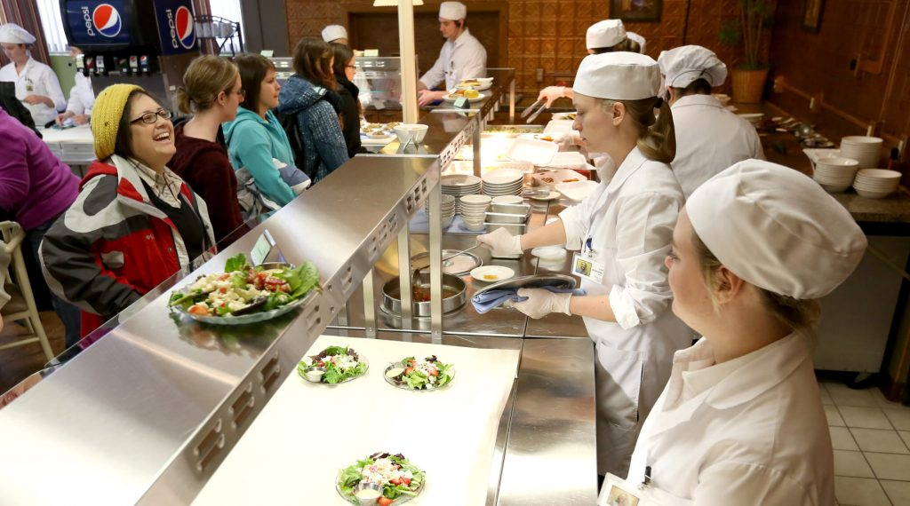 UW-Stout students serve food at a campus café as part of the Quantity Food Production class. The university's School of Hospitality Leadership has been ranked No. 10 in the world by CEOWorld magazine.