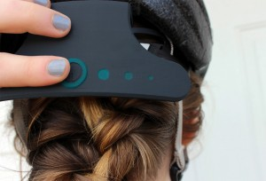 UW-Stout student Samantha Floersch designed a helmet-mounted attachment for mountain bikers that tracks location, takes vitals and plays music.