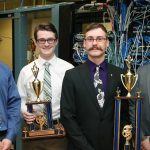 From left, UW-Stout students who placed in a national computer network design contest are Nathanael Satnik and Corey Schoff, third place; and Dan Schmidt and Brandon Wolf, first place. They hold their trophies in a computer networking lab in Fryklund Hall.