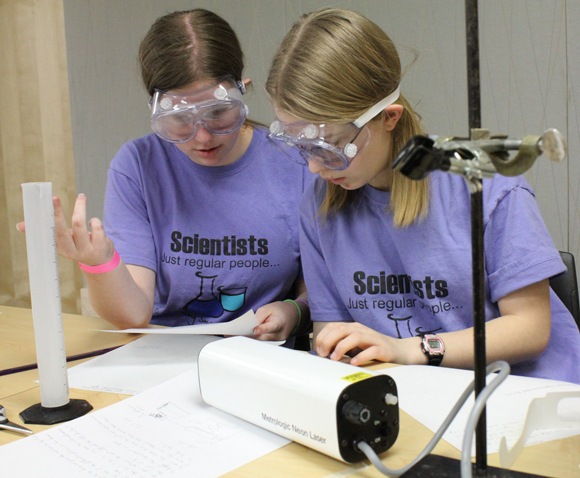 Students work on a problem during a recent state Science Olympiad at UW-Stout. The state meet returns to campus April 1-2, followed by the national meet May 18-21.