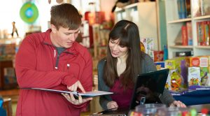 Erin Wolfe, right, opened The Toy Shop in downtown La Crosse in July 2015 with her husband, Adam. Here she meets with UW-La Crosse student Matt Hemmersbach, who helped create a marketing plan for her business as part of a class project. UWL's Small Business Development Center helped link the two.