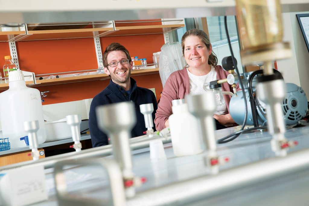 """You can never have too many water samples,"" said microbiologist Sandra McLellan (right), who ships a water sample from every place she visits back to the McLellan Lab. With colleague Ryan Newton (left) she sampled water from 71 U.S. cities for a major NIH study. (UWM Photo/Troye Fox)"