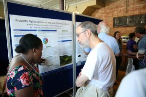 Eniola Afolayan, a UW-Stout LAKES researcher from University of Mary Washington in Virginia, talks about her project during a 2015 community presentation at the Raw Deal in Menomonie.