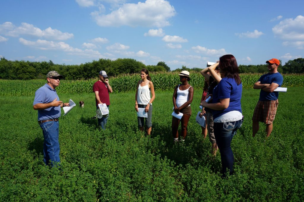 LAKES REU students at UW-Stout visit an area farm in 2014 as they conduct research on the social impact of poor water quality in the Red Cedar River watershed.
