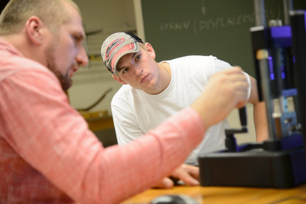 A UW-Oshkosh student works with a faculty member.