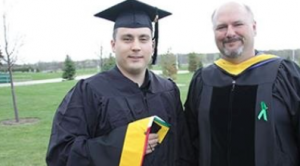 Matthew Christianson, UW System's first Sustainable Management master's degree graduate, with professor John Katers.