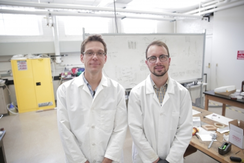 (from left) Associate Professor Michael Arnold and graduate student Gerald Brady, the lead author on the Science Advances paper. By making carbon nanotube transistors that, for the first time, surpass state-of-the-art silicon transistors, the researchers have achieved a big milestone in nanotechnology. Photo: Stephanie Precourt/UW–Madison College of Engineering