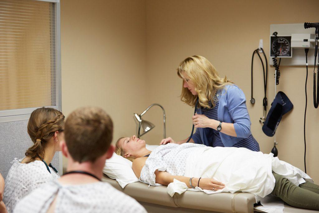 Sandra Sieck, UW-La Crosse's PA program director, demonstrates during a class in the Physician Assistant Studies program.