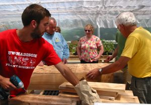 Mike Geiger (left) at a hydroponic salad table workshop at the greenhouse. All photos courtesy of Mike Geiger.