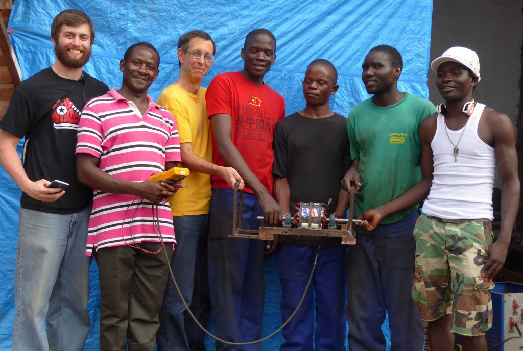 Hastings Mkwandwire and other village residents experimented with ways to build generators. UW-Stout student Josh Miller, left, later built a new prototype. Miller and Professor Tom Lacksonen, third from left, visited Malawi in January.