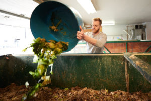 UWL Senior and Vermicomposting Intern Jeremy Shimetz collects more than 400 pounds of compost a week from both UWL's Whitney Center and Mayo Clinic Health Systems to feed the worms.