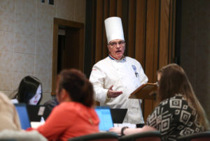 Professor Phil McGuirk teaches a Principles of Food Service Operations class in Heritage Hall at UW-Stout.