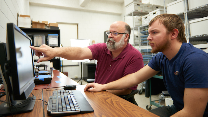 From left, David Anderson, UWL associate professor of archaeology, and UWL senior William Feltz are using cutting edge technology to make ancient artifacts easier to see — and feel.