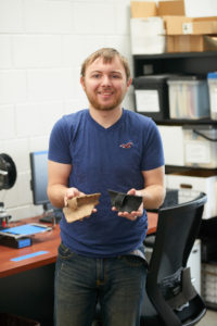 UWL senior William Feltz holds a pottery fragment and a 3D printed model of one. After graduating, Feltz will begin work as a field technician for a Colorado State University archaeology excavation project at Ft. McCoy to analyze archaeological remains from the site prior to building.