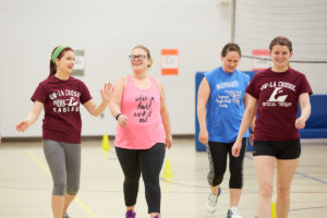 Summit Elementary School Special Education teacher Kasey Pomeroy, center, takes warm up laps with UWL Physical Therapy Students Brenna Dubick, left, and Abigail Bishop. The Physical Therapy students helped design a free and convenient fitness program at the La Crosse school to motivate more adult physical activity.