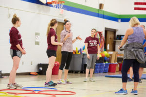 UWL Physical Therapy graduate student Elizabeth Skaer shares educational information during a break time in the circuit training at Summit Elementary School in La Crosse. The fitness program the UWL Physical Therapy students created has a unique blend of aerobic activity and education. It is one of many PT program health and wellness initiatives UWL students are creating throughout the community.