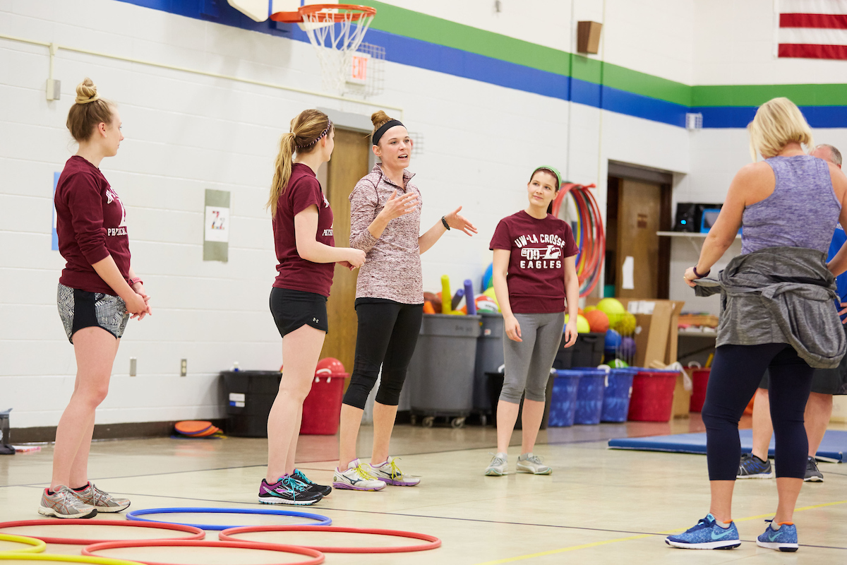 UWL Physical Therapy graduate student Elizabeth Skaer shares educational  information during a break time in the