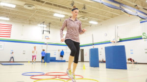 UWL graduate student Elizabeth Skaer helps lead a free fitness program for Summit Elementary School staff. The program is one of many community health and wellness programs led by UWL Physical Therapy students this semester.