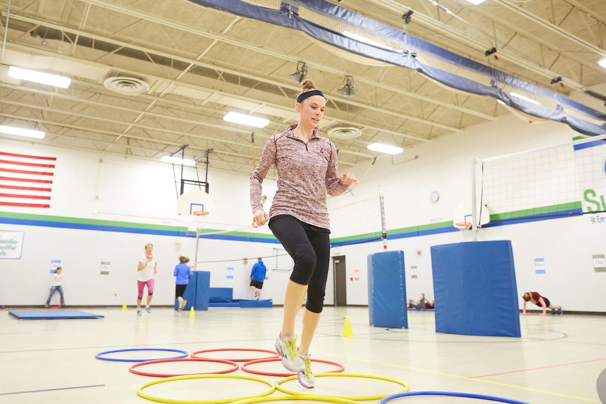 UWL graduate student Elizabeth Skaer helps lead a free fitness program for  Summit Elementary School staff