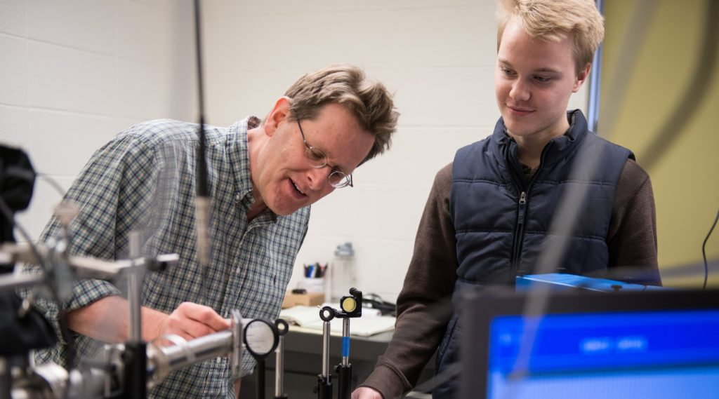 Photo of Dr. Stephen Drucker, professor of chemistry, and a student