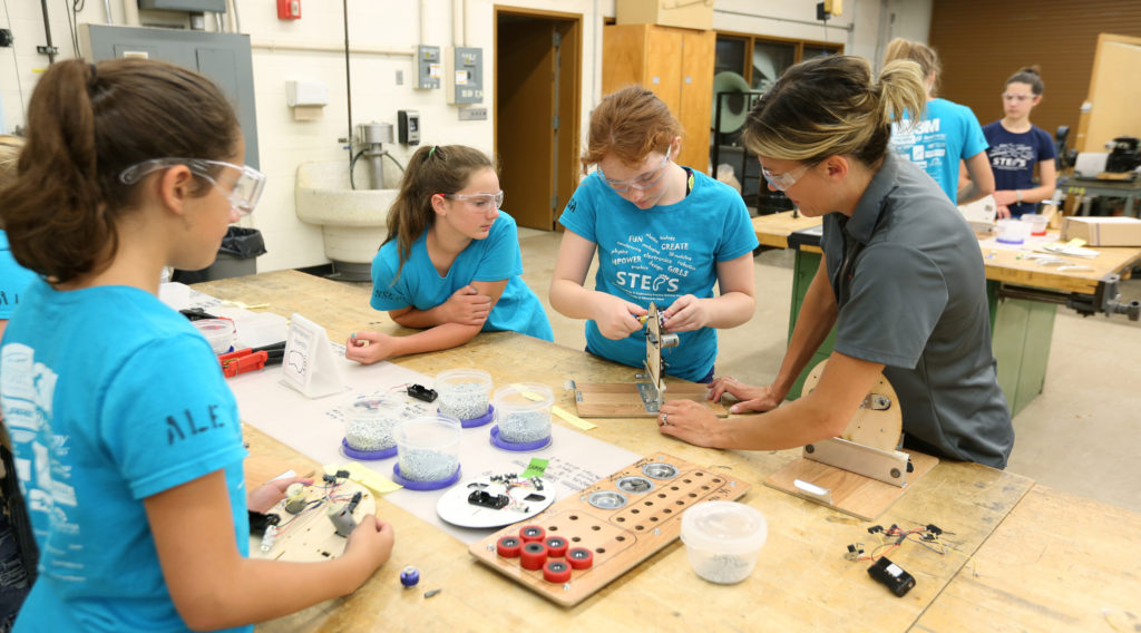 Kari Berthiaume helps STEPS for Girls participants with their robot projects in an engineering lab at UW-Stout.