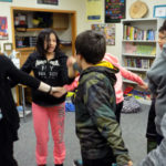 UW-Stout student Skylar Kitchner leads a career and education development activity with LCO sixth-graders.