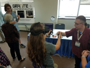 Photo of UW-Stout students Austin Lewer, left, and Daniel Johnson, explaining the Granite virtual reality project at the WiSys innovation symposium held in July at UW-Platteville.