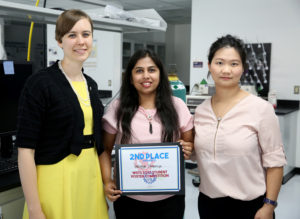 Photo of UW-Stout student Pratigya Thapaliya, center, receiving a WiSys innovation symposium certificate from Kristen Ruka, left, WiSys regional associate. At right is project director Assistant Professor Min DeGruson.