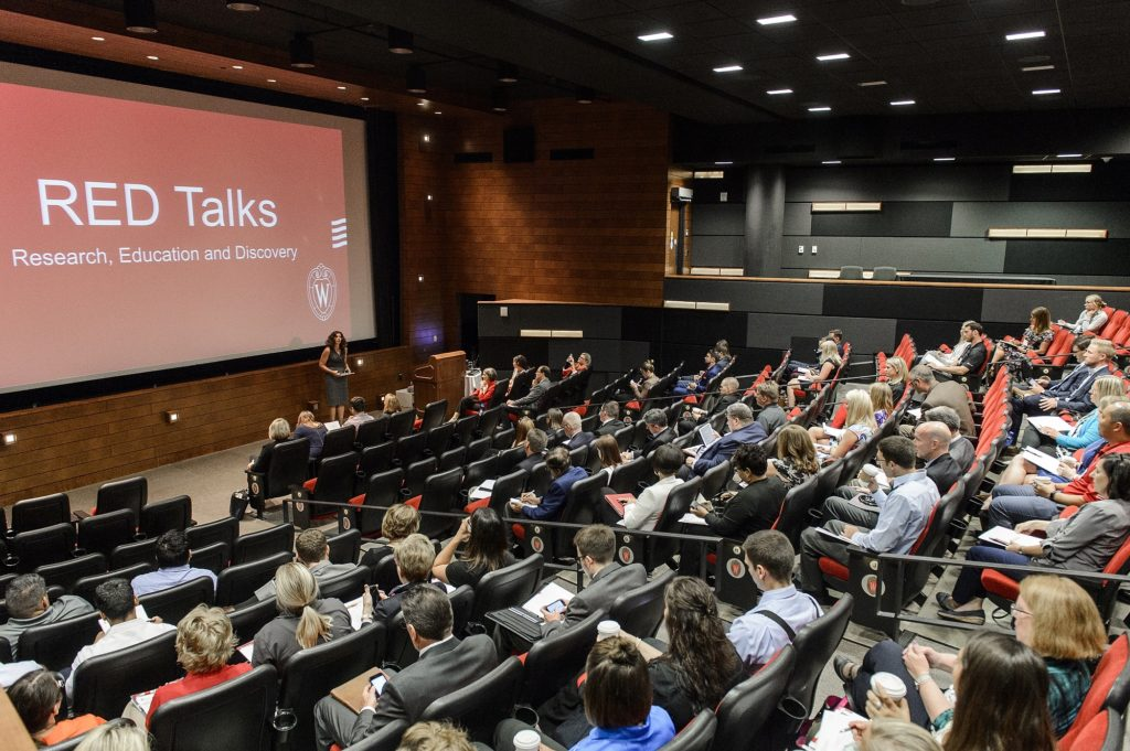 Photo: A series of talks, titled RED Talks, are presented by UW faculty and staff during the Office of Corporate Relations (OCR) Day On Campus event held in Varsity Hall in Union South at the University of Wisconsin-Madison on Aug. 23, 2017. (Photo by Bryce Richter / UW-Madison)