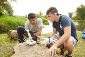 Photo of Niti Mishra, left, a UW-La Crosse assistant professor of Geography and Earth Science, who has a license to fly a drone up to 400 feet. This one is capable to flying up to 1,600 feet. Mishra is pictured with UWL senior Zachary Woodcock who is learning to fly drones while assisting a local organization with invasive species monitoring with help from Mishra.