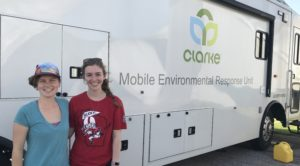Photo of Melissa Farquhar (left) and Erin McGlynn, UW–Madison professional students, standing outside the Clarke mobile entomology lab, where they are working to identify mosquitoes to assist mosquito-control efforts following Hurricane Harvey. (Photos courtesy Erin McGlynn and Melissa Farquhar)
