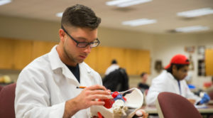 Photo of a UW-Platteville student working in a health lab