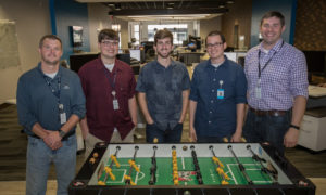 Photo of Sentry managers and student-employees from UW-Stevens Point who work and occasionally play at the Sentry IT Co-op.